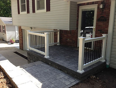 Finished Porch with white fenc and stone walk