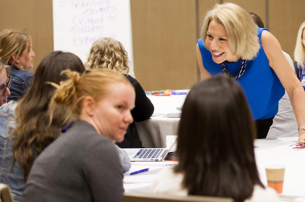 Dr. Fran Prolman working with women