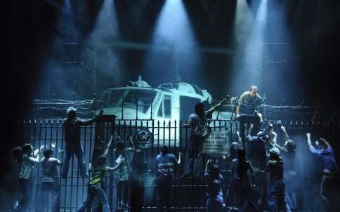Helicopter descends on the stage during a Miss Saigon performance on Broadway.