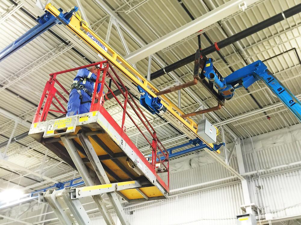 Kristian installing a Gorbel Ceiling Hung Workstation Crane