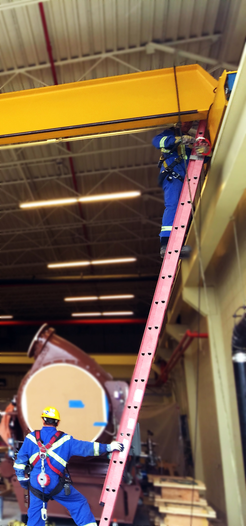 Kristian Electric technicians performing preventative maintenance on an overhead bridge crane.