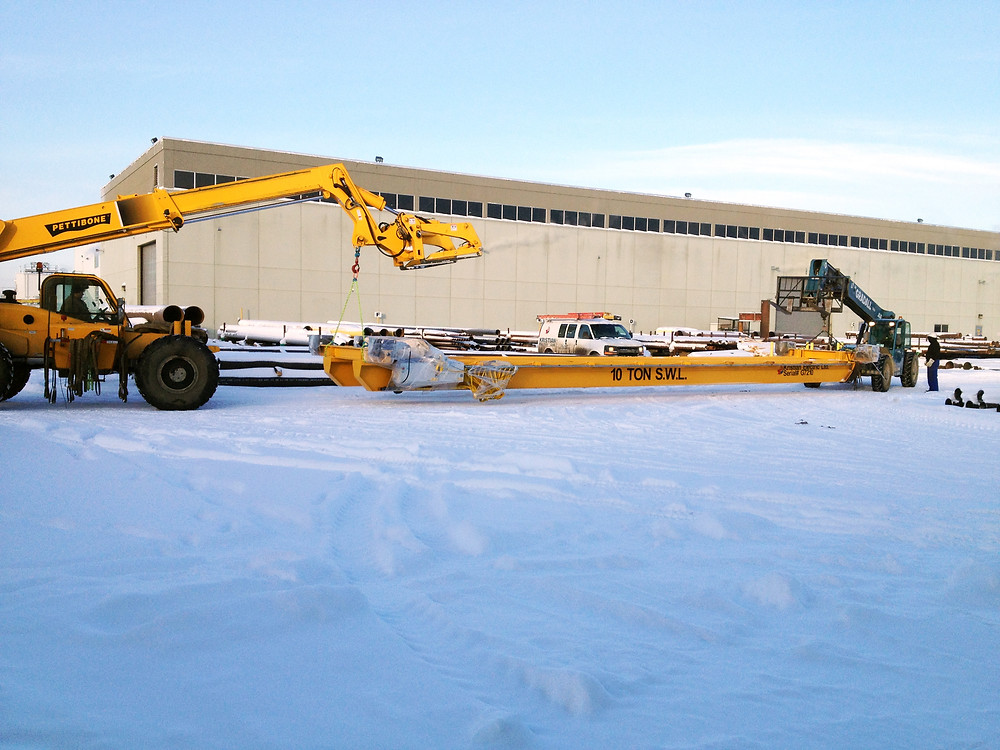 Moving a new 10 ton URDG into the building for installation in 2013.