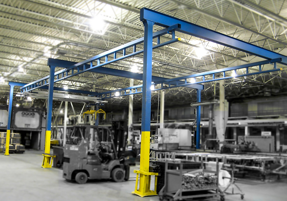 Freestanding Gorbel workstation crane with 3 aluminum bridges.