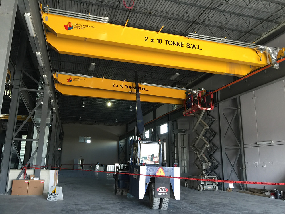 The Kristian Electric installation team had to install these 2x10 tonne double girder cranes while on the runway.  Which is no easy task.