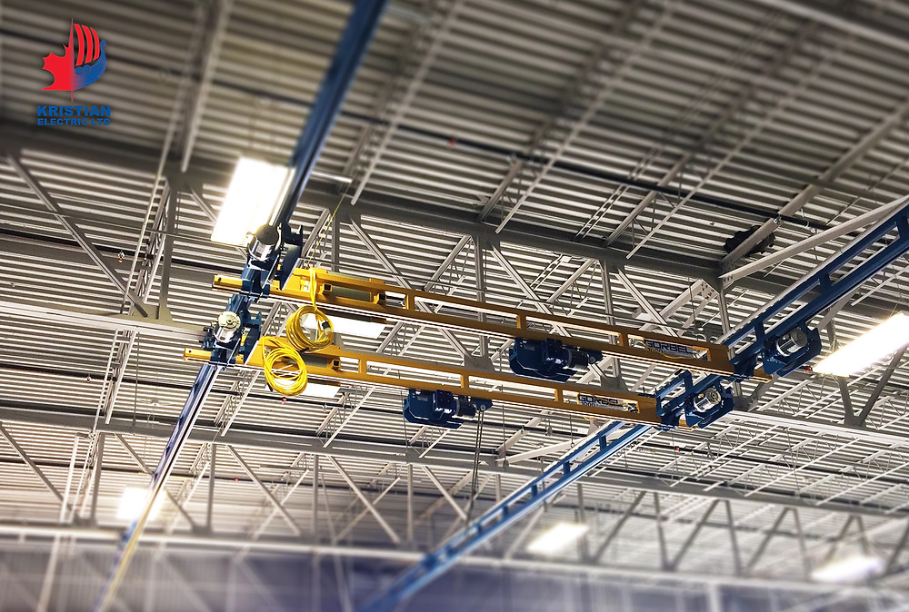 Ceiling hung, motor driven Gorbel workstation crane