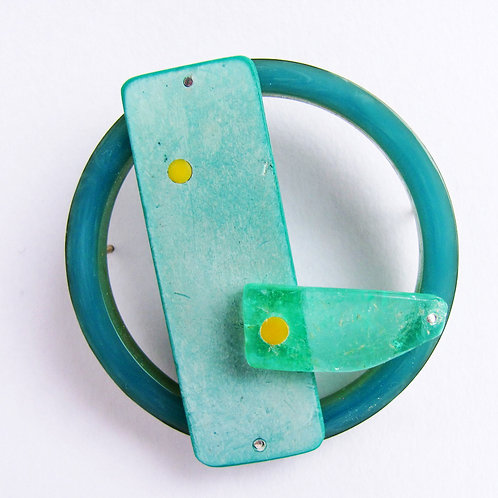 Found: Green and Yellow Round Brooch