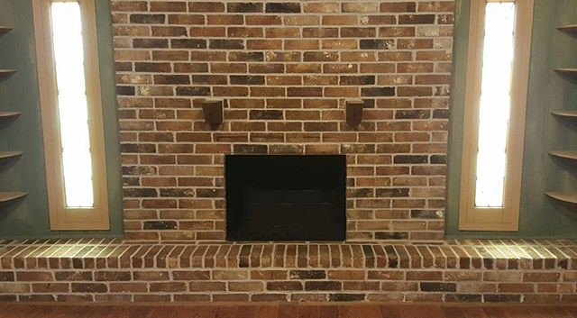 After picture of fireplace restoration.jpg Mortar joints re-done.jpg Lightly acid washed and custom stained as needed.jpg