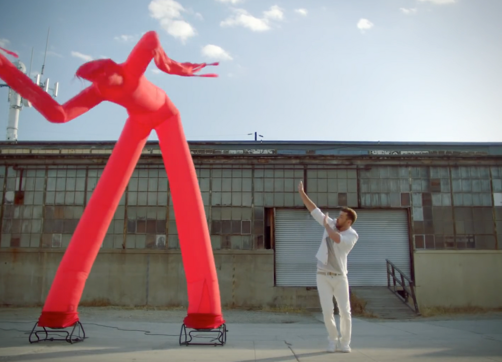 Justin Timberlake dancing with Inflatable Man