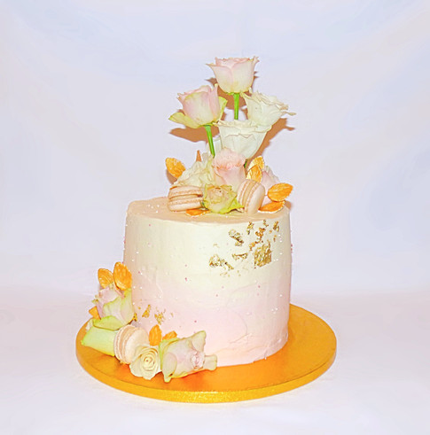 Pink ombre and gold roses cake