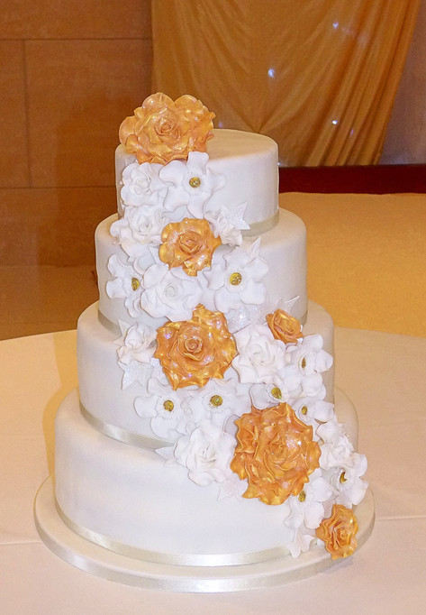 White and Gold Floral Cascade Wedding Cake
