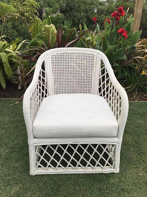 White cane arm chair with cushion