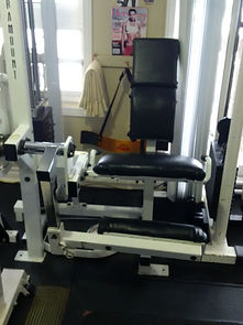 personal training, thigh extension machine in personal training studio