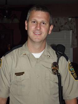 Chris in his Albemarle County Police uniform