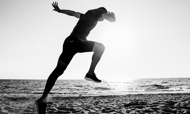 male running on beach.png