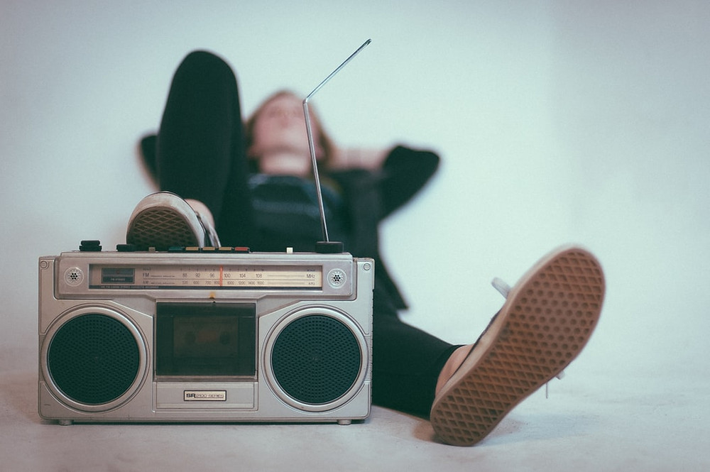 Person relaxing with a retro radio