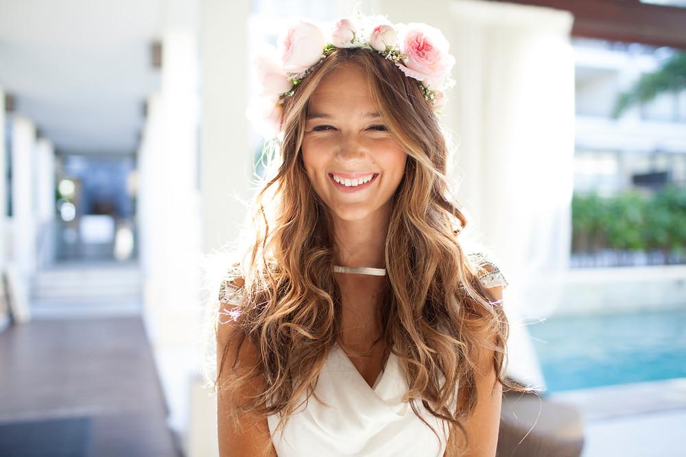 A Greek destination wedding bride wearing her flower crown smiling under the sun