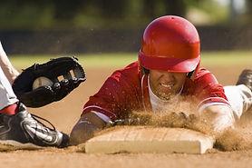 Closeup of a baseball player sliding to