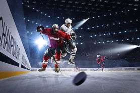 Hockey players shoots the puck and attac