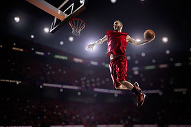 red Basketball player in action in gym.j