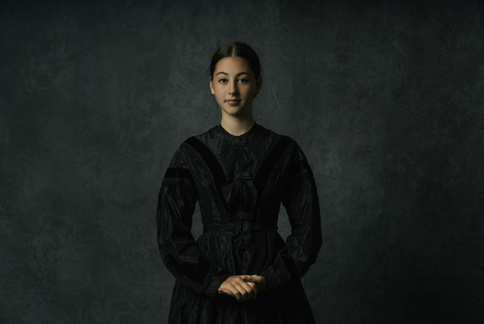 One of my favourite fine art images. Simple but strong lighting.  Wearing a very special dress from one of the first settlers in NZ.