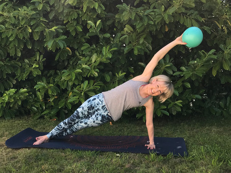 Here's how to enhance your Pilates Practice with Mini Balls.