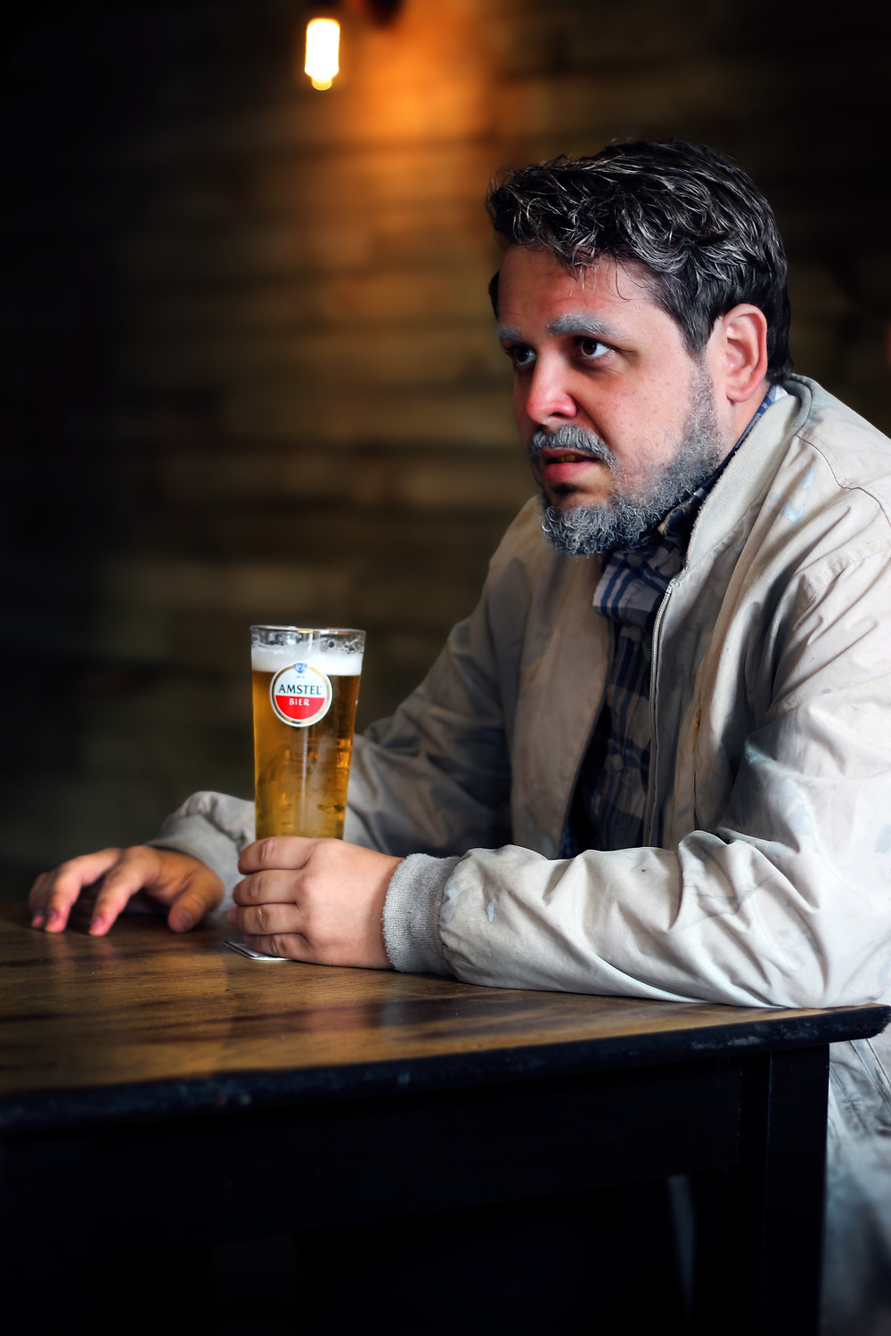 Tom Stevenson as Engstrand with a beer in hand