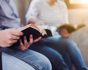 Christian friends group reading and study bible together in home or Sunday school at churc