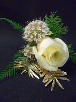 white and gold boutonniere