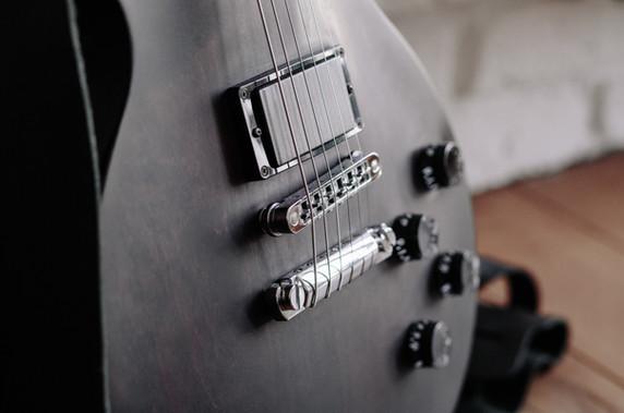 close-up-photo-of-black-electric-guitar-