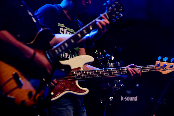 photo-of-people-playing-electric-guitars