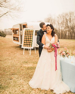 Stunning bride ✔️_Dapper groom ✔️_Pretzel wall ✔️_Gorg florals ✔️_Awesome retro camper bar ✔️