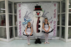 Snow man and helper group photo