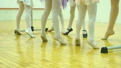 Little ballerina legs and feet in class