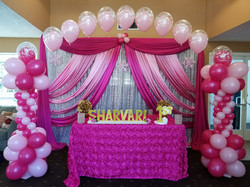 Pink balloons with table
