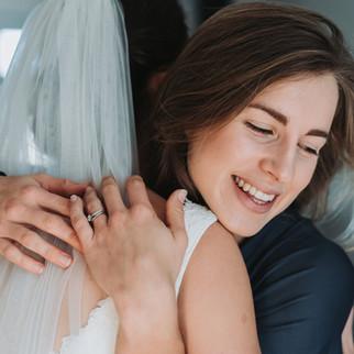 Hugging the bride