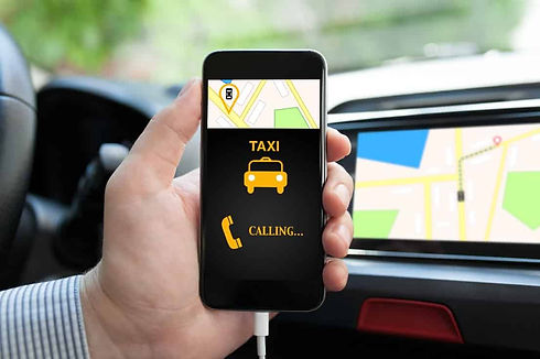 man inside taxi cab holding phone with c