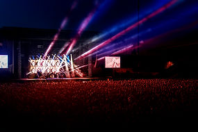 concert with stage, lighting and crowd