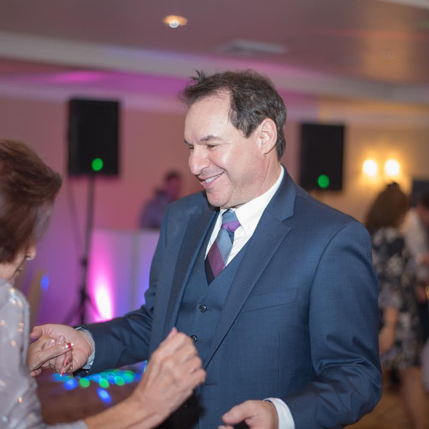 Bat Mitzvah father dancing with his mother