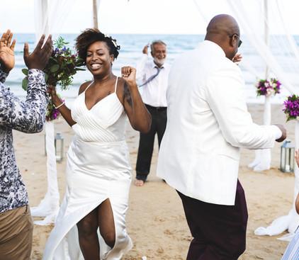 Wedding Couple Celebrating on The Beach