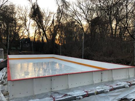 Mini 20x40 rink, 2 foot high boards.