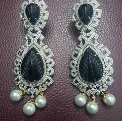 carved stone diamond long earring