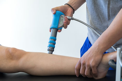 physical therapy of the knee and the foot with shock wave.jpg