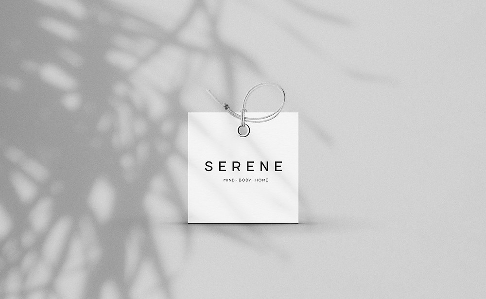 serene logo on square swing tag mockup with plant shadow background