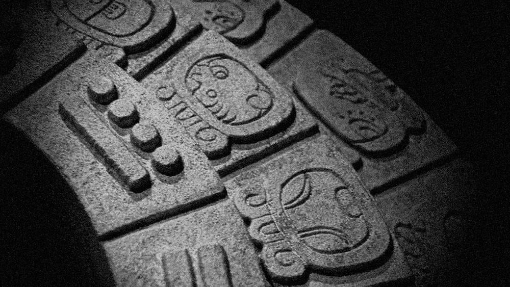 Close up of Maya Tzolkin Calendar glyphs