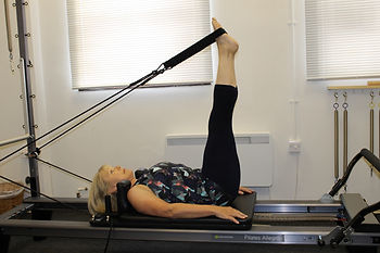 Preparing for hip circles on the Pilates Reformer. Getting a great hamstring stretch!