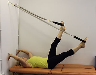 Person exercising on a Pilates Arc