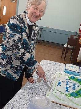 Rev. Susan cutting her cake