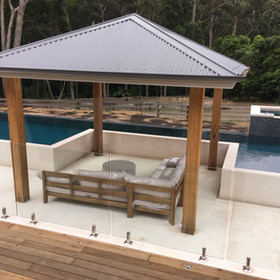 Modern standstone and timber raised pool area