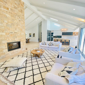 Renovation with exposed rafters in a coastal style