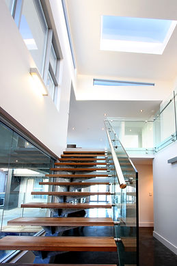 Open riser timber and steel stair